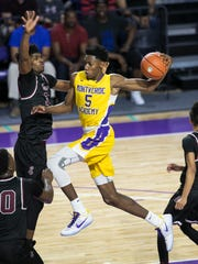 Memphis East's Antavion Collum guards Montverde Academy's RJ Barrett as he goes up for a shot in the finals of the 44th Annual City of Palms Classic on Wednesday, December 21, 2016, at Suncoast Credit Union Arena in Fort Myers. Barrett was named the tournament MVP.