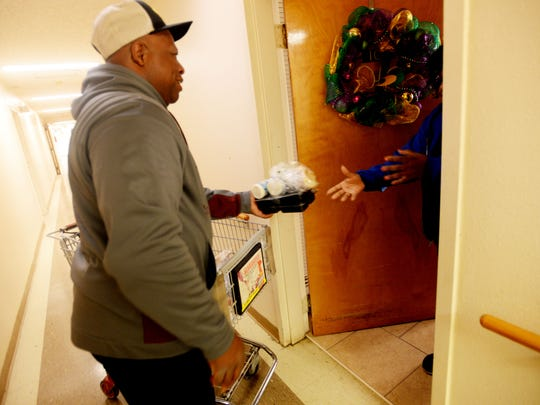 John Clay delivers food to people in the Meals on Wheels