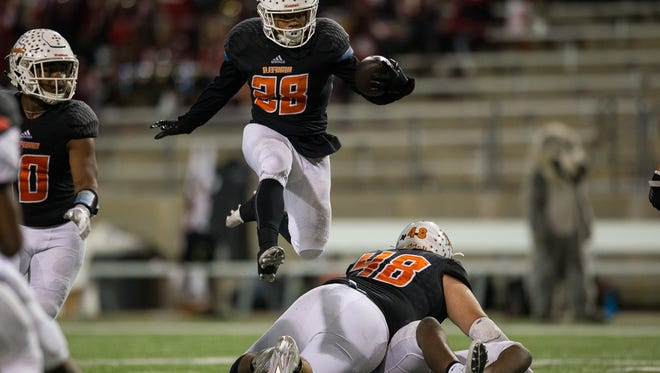 Refugio's Daryon Ramirez jumps over players as he runs the ball during the third quarter of the Class 2A D-I State Semifinal game against San Augustine at Cy Fair FCU Stadium in Cypress, Texas on Thursday, Dec. 14, 2017.