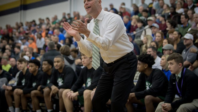 Trinity's head coach Mike Szabo encourages his team during their game against Cooper at the King of the Bluegrass Holiday Classic in Fairdale, Ky, Thursday, Dec. 22, 2017