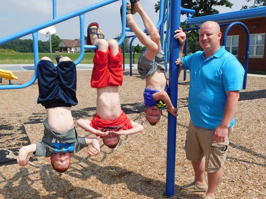 Adam Greenslade takes his sons to the Green Springs Elementary School playground to work off some energy.