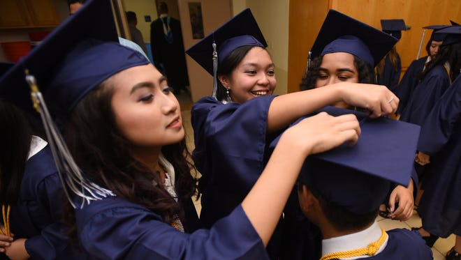 Graduating seniors of Harvest Christian Academy share some time together before their commencement exercises at the school on Friday, May 19, 2017. Eighty-two Eagles were listed in a program to have recieved their high school diplomas during the graduation ceremony.