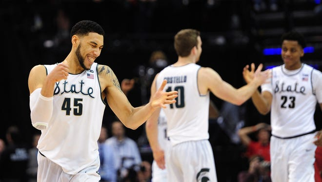 Michigan State Spartans guard Denzel Valentine(45) celebrates after defeating the Maryland Terrapins 64-61 during the Big Ten Conference tournament at Bankers Life Fieldhouse.