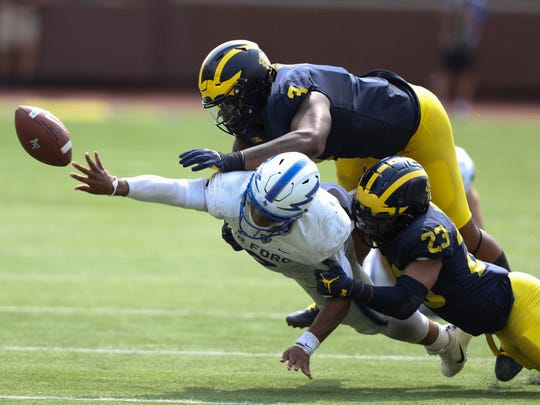 Michigan's Rashan Gary (3) and Tyree Kinnel force a fumble by Air Force's Arion Worthman on Saturday, Sept. 16, 2017 at Michigan Stadium.