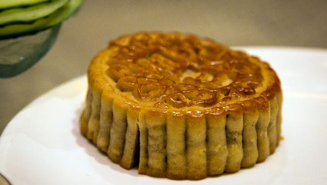Mooncake served to us at dinner Monday in Handan, China by our hosts. About hockey puck-sized, it is served during the Mid-Autumn Festival.
