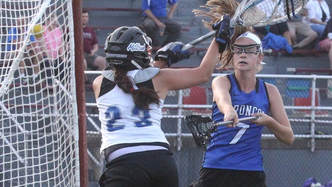 Bronxville's Lucy Hanrahan scores past Millbrook goalie Claire Martell during their lacrosse sub-regional at Dietz Stadium in Kingston June 1, 2016.