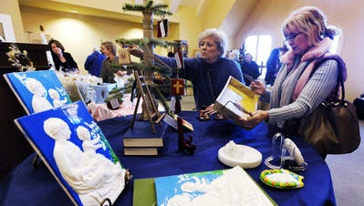 Evie Yonker and Sheila Lockett browse through artwork as St. John's Episcopal Church holds it's annual bazaar and luncheon at the church In Montgomery, Ala. on Wednesday November 19, 2014.