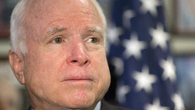 Sen. John McCain, R-Ariz., talks about murdered American hostage Kayla Mueller during a Feb. 13, 2015, news conference at his Phoenix office.