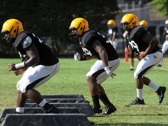 Linebacker Brian Anderson (39), center, runs drills Wednesday morning during a Southern Miss football practice.