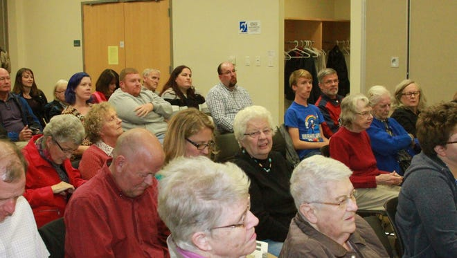 The audience listens to the candidates during the Candidate Forum sponsored by the League of Women Voters in Grinnell and the Grinnell Chamber of Commerce at Drake Community Library in Grinnell on Wednesday, Oct. 12.