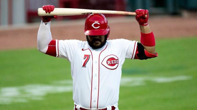 Cincinnati Reds third baseman Eugenio Suarez (7) reacts to striking out in the sixth inning of the game against the Chicago Cubs at Great American Ball Park in Cincinnati on Tuesday, July 28, 2020.