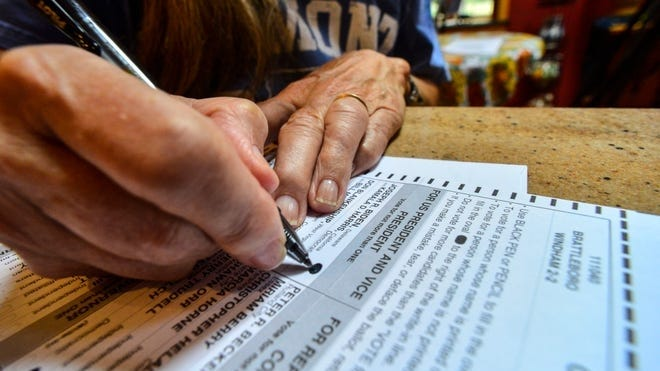 Susan Avery of Brattleboro, Vt., fills out the ballot she received in the mail on Sept. 28.  Kristopher Radder, The Brattleboro Reformer via AP