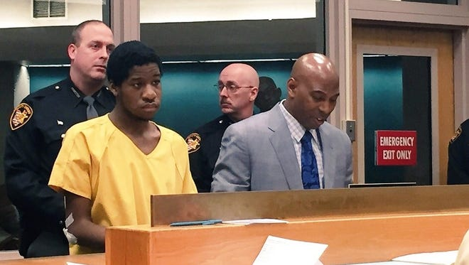 Andrew Kimbrough, left, appears in court Wednesday morning. A judge set his bond at $250,000 each for a charge of felonious assault and murder.