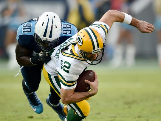 Titans outside linebacker Brian Orakpo (98) brings down Packers quarterback Aaron Rodgers (12) in the second half at Nissan Stadium Sunday, Nov. 13, 2016, in Nashville, Tenn.