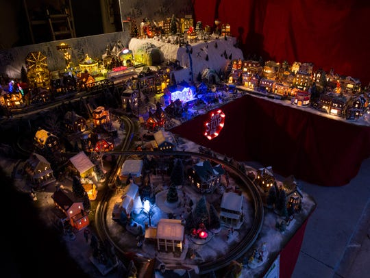 Sharon Ardrey hosts a Christmas party with a large model train display as the backdrop Friday, Dec. 22, 2017, in East Naples.
