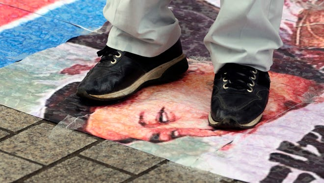 A South Korean protester tramples a caricature of North Korean leader Kim Jong Un during a rally denouncing North Korea's latest nuclear test, in Seoul, South Korea, on Monday.