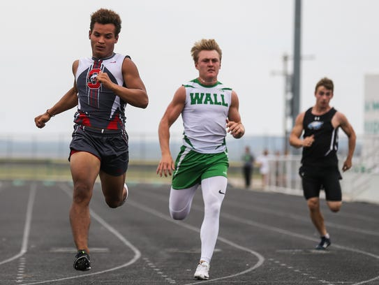 Wall's Sutton Braden races against Sonora's Jarrett Jackson races in the 100 meters during the District 4-3A Track and Field Championships, April 6, 2018, in Wall. Braden made it to the finals of the race at the Region I-3A meet April 28, 2018, in  Abilene before opting to forgo running in the race to concentrate on Wall's 4x200 relay.