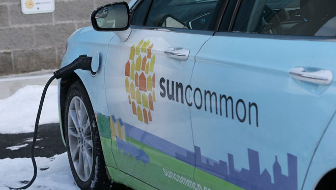 A SunCommon electric car charges at one of the charging stations at SunCommon in Ontario Tuesday, Feb. 6, 2018.