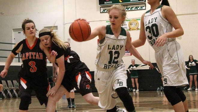 Cloudcroft's Laura Quick, 12, dribbles the ball through heavy traffic Tuesday night at Cloudcroft High School.