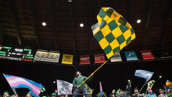 Portland Timbers fans celebrate after a game against the Colorado Rapids at Providence Park. The Timbers won 1-0.