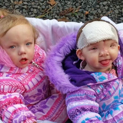 Twins Cora and Violet Pietrok of Stayton take an outdoor