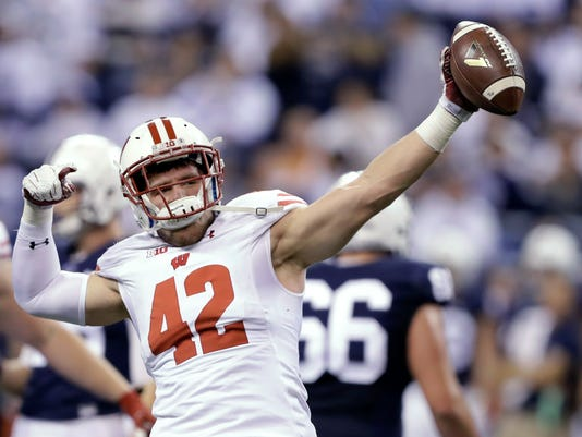 FILE - In this Dec. 3, 2016, file photo, Wisconsin's T.J. Watt celebrates after recovering a fumble during the Big Ten championship NCAA college football game against Penn State in Indianapolis. Watt has a chance to get selected in the first round of the NFL draft on Thursday, just like his brother J.J. in 2011. (AP Photo/Michael Conroy, File)