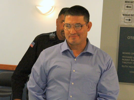 Joe D. Chavez Jr. is led out of 12th Judicial District