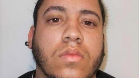 Police arrested and charged Luis Baez, 22, of Boston, in connection with fatally striking Jennifer Toscano, 34, of Stoughton, who was helping rollover victims in Rhode Island.