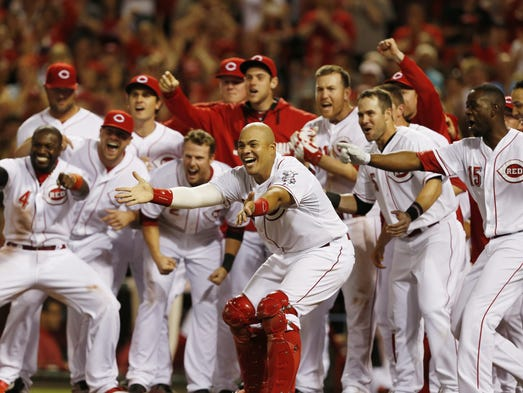 Cincinnati Reds Brayan Pena (29) along with the rest of the team waits for Joey Votto (19) after his game winning home run in the ninth inning beating the Colorado Rockies 4-3 at Great American Ball Park.