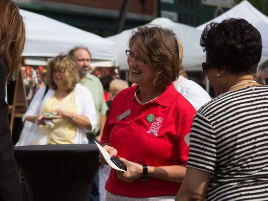 Brenda Hunt greets people at the Battle Creek Community Foundation's Annual Meeting on Wednesday.