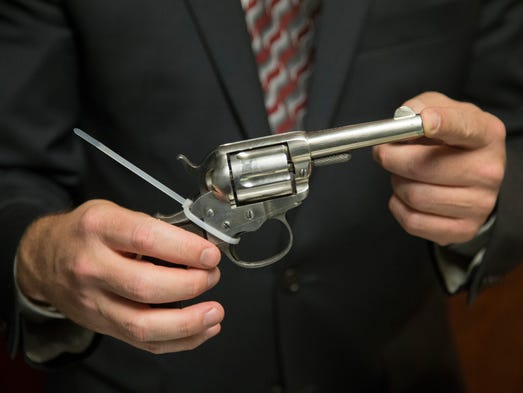 Josh Levine shows off a Colt Lightning Revolver that Wyatt Earp used in the 1880s. The item will be auctioned at J Levine Auction & Appraisal in Scottsdale on July 31, 2014.