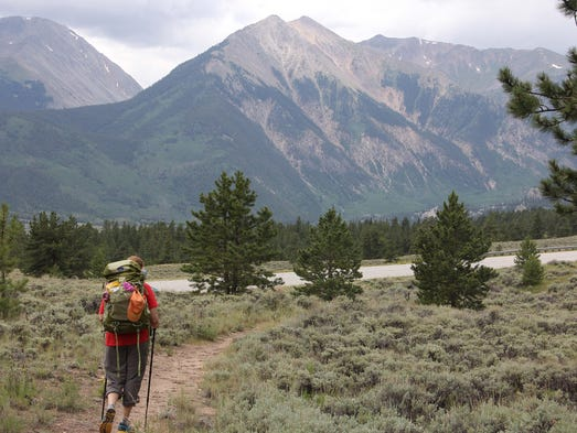 Hiker Dayle Johnson of Springfield walks toward Twin Lakes with a panoramic view of the Collegiate Range before her.