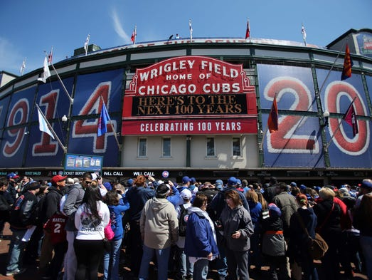 """Wrigley Field, home of the Cubs, turns 100 today. The sign on the stadium reads: """"Here's to the next 100 years."""""""