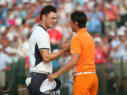 Martin Kaymer (left) is congratulated by Rickie Fowler (right) after Kaymer putted out on the 18th green during the final round of the 2014 U.S. Open golf tournament at Pinehurst Resort Country Club - #2 Course.