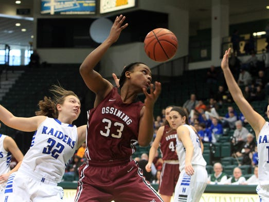 Ossining's Jalay Knowles (33) pulls down a rebound against Horseheads' during the girls Class AA regional state championship basketball game at Binghamton University March 8, 2014. Ossining won the game 69-52.