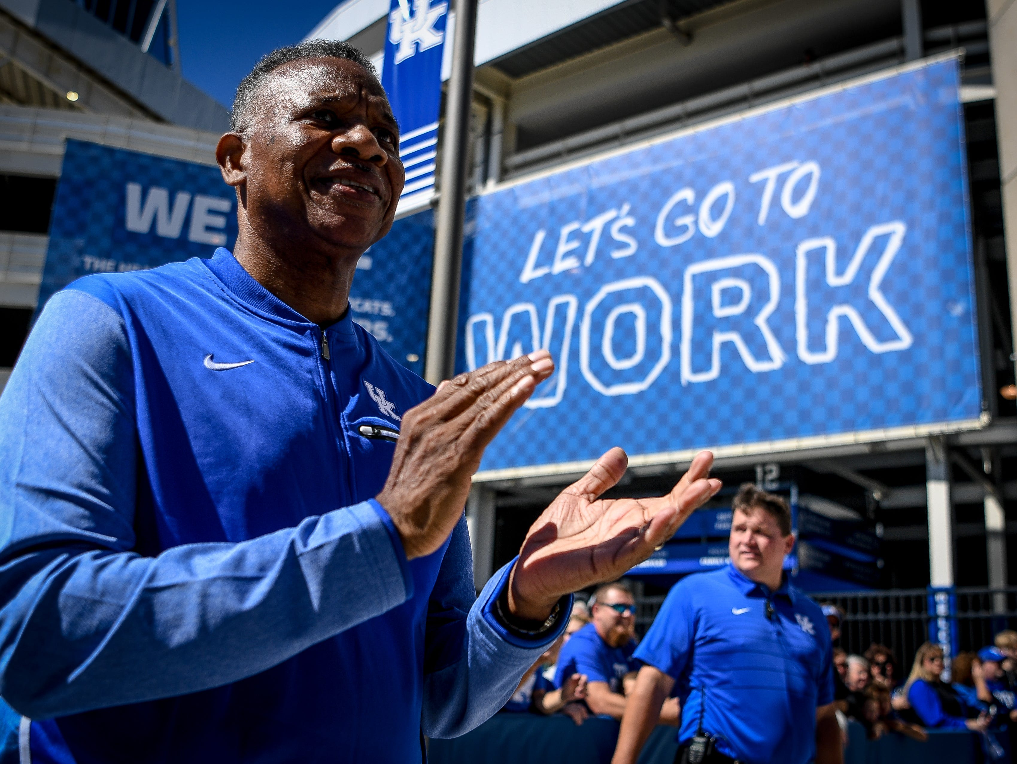 Nate Northington, former Wildcat defensive back, and the first African-American to play in a Southeast Conference football game, greets the Wildcats as they arrive at Froger Field prior to the game against Eastern Michigan University in Lexington on September 30, 2017.