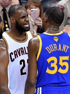 LeBron James of the Cleveland Cavaliers and Kevin Durant of the Golden State Warriors speak after a foul in the third quarter in Game 4 of the 2017 NBA Finals.