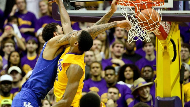Kentucky Wildcats forward Willie Cauley-Stein (15) dunks over LSU Tigers forward Jordan Mickey (25) during the second half of a game at the Pete Maravich Assembly Center. Kentucky defeated LSU 71-69.