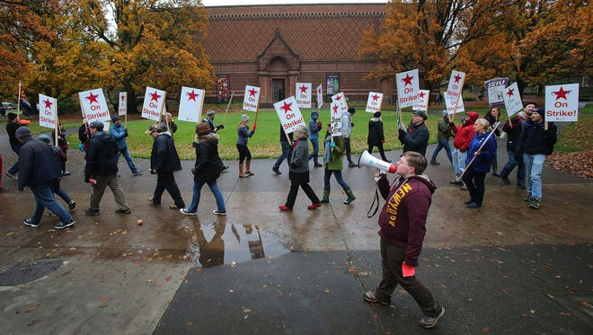 Graduate teachers and supporters march in near the UO memorial quad on the University of Oregon campus in Eugene, Ore., on Tuesday, Dec. 2, 2014. The Graduate Teaching Fellows Federation is beginning a strike Tuesday for the first time in the labor union's 38 years on the UO campus. Talks between UO officials and the union broke down Monday night over the union's demand for two weeks of paid medical and parental leave. (AP Photo/The Register-Guard, Brian Davies)