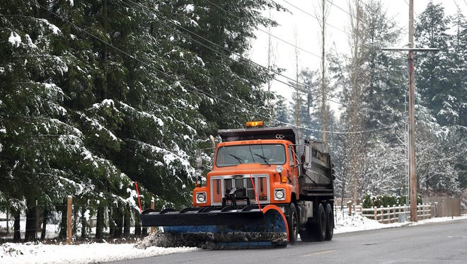 A Kitsap County snow plow clears the slush during a snowstorm in 2016.