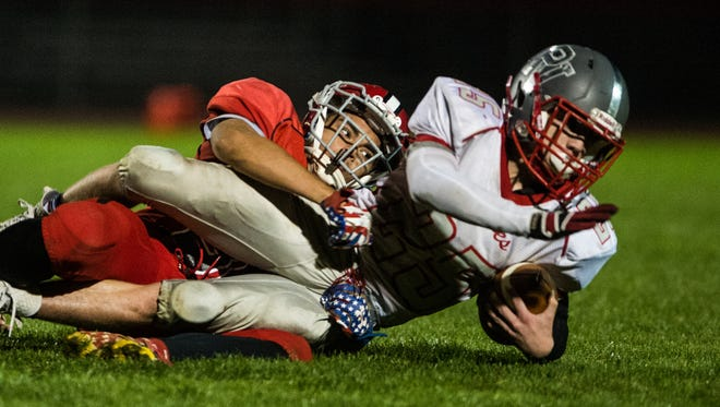 Annville-Cleona's Romeo Varela brings down Pequea Valley's Tanner Ball as Annville-Cleona beat Pequea Valley 22-14 on Friday Oct. 27, 2017.