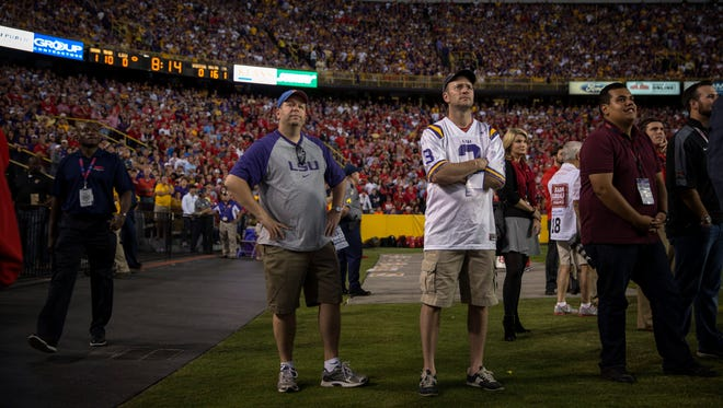 Jarrett Singer and Al Botta, two friends from New York, take in the scene at Tiger Stadium in Baton Rouge on Oct. 25, 2014, as LSU plays Ole Miss.