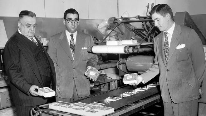 March 1, 1951 - One of the features of the new Montesi Supermarket No. 2 at 3362 Summer Avenue, which opened in March 1951, is this automatic meat wrapping machine. On hand to make sure everything was in order were Fred Montesi (left) and two of his sons, Louis  Montesi (center) and Joe Montesi.