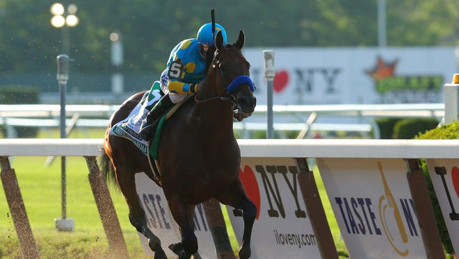 American Pharoah with Victor Espinoza wins the 2015 Belmont Stakes at Belmont Park.