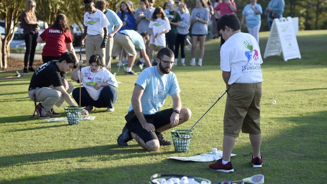 Coaches help kids with their game during the All-Star Kids Clinic at the First Tee of Augusta in November 2019.
