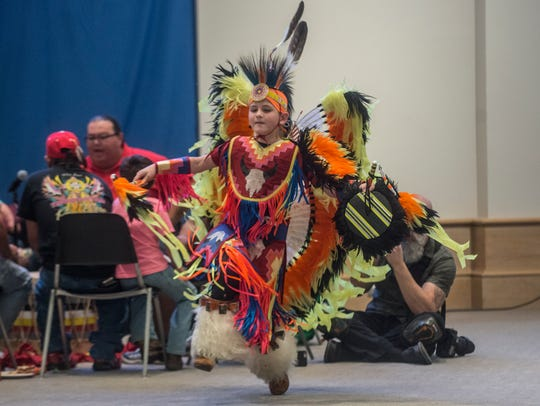 Dancers perform as the Poarch Band of Creek Indians'