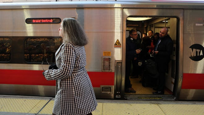 Kathryn Heintz looks to notify a conductor about a commuter in a wheelchair that needs assistance getting on the overcrowded 7:57a.m. train at the Mount Vernon East station Dec. 4, 2017.