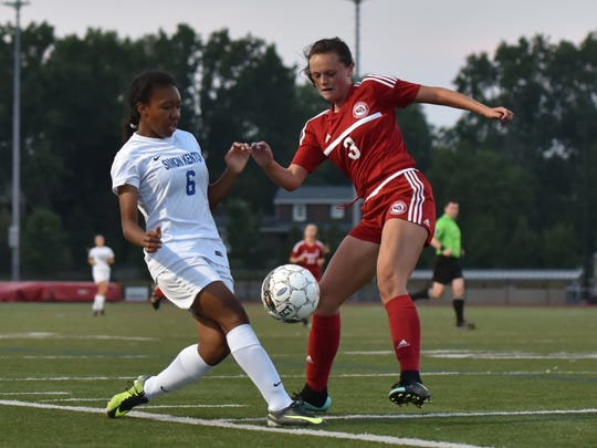 Simon Kenton's Cayla Coleman has a pass deflected by St. Henry's Erin Cheek at Soccerama at Dixie Heights High School Friday, August 11th