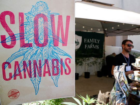 """A banner for """"Slow Cannabis"""" is displayed at the Emerald"""