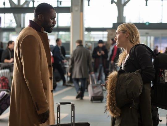 Ben (Idris Elba) and Alex (Kate Winslet) meet at an